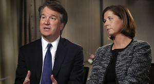 Brett Kavanaugh, with his wife Ashley Estes Kavanaugh, answers questions during a Fox News interview (Jacquelyn Martin/AP)