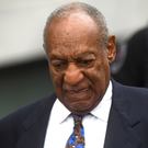 Disgraced: Bill Cosby is led away from court in handcuffs