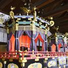 The Takamikura throne, left, and Michodai, a curtained platform, placed at the Kyoto Imperial Palace (Kyodo News via AP)