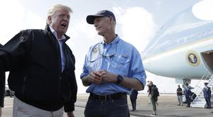 President Donald Trump speaks to the media with Florida Governor Rick Scott (Evan Vucci/AP)