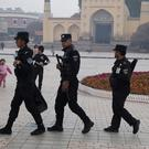 Uighur security personnel patrol near the Id Kah Mosque in Kashgar in western China's Xinjiang region (AP)