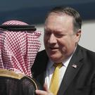 US secretary of state Mike Pompeo, right, greets Saudi foreign minister Adel al-Jubeir (Leah Millis/AP)