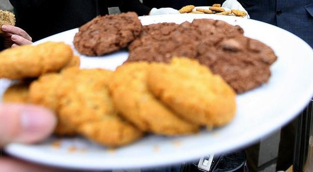 The student and a friend baked the biscuits and shared them with at least nine classmates, police said (Julien Behal/PA)