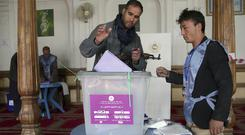 A policeman casts his vote in parliamentary elections in Kabul, Afghanistan (Massoud Hossaini/AP)