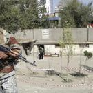 A policeman stands guard after a bomb explosion near a polling station in Kabul, Afghanistan (AP Photo/Massoud Hossaini)