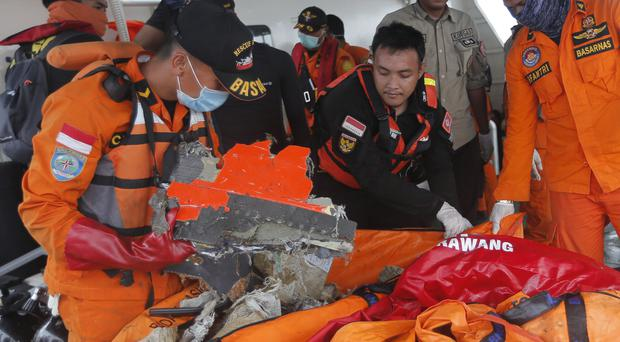 Rescuers examine parts of the crashed Lion Air plane (Tatan Syuflana/AP)