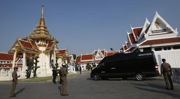 A hearse carrying the body of Thai billionaire and Leicester City owner Vichai Srivaddhanaprabha arrives at Debsirindrawas Temple in Bangkok,(Sakchai Lalit/AP)