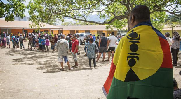 Voting gets under way in New Caledonia (AP)