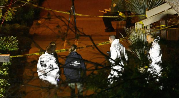 A forensics team works the scene in Thousand Oaks (Mark J Terrill/AP)