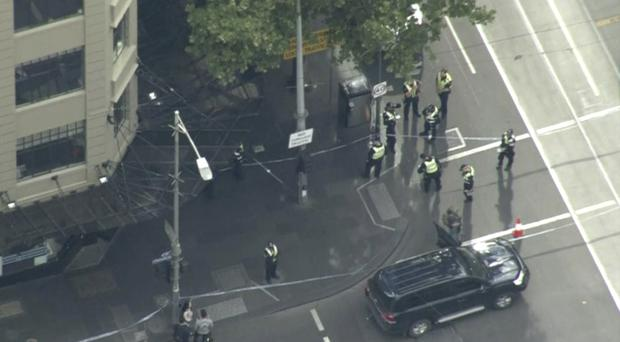 Police at the scene in Melbourne (Australian Broadcasting Corporation via AP)