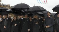 (From L) Moroccan King Mohammed VI, German Chancellor Angela Merkel, French President Emmanuel Macron and his wife Brigitte, and Canadian Prime Minister Justin Trudeau walk towards the Arc de Triomphe (Ludovic Marin/Pool Photo via AP)