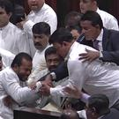 Sri Lanka's lawmakers scuffle at the parliament in Colombo (AP)