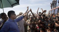 A Bangladeshi officer tries to calm Rohingya refugees during a protest against repatriation (Dar Yasin/AP)