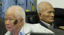 Khieu Samphan, left, and Nuon Chea are already serving life sentences (Mark Peters/Extraordinary Chambers in the Courts of Cambodia/AP)