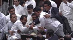 Sri Lanka's lawmakers scuffle at the parliament in Colombo (AP Photo)