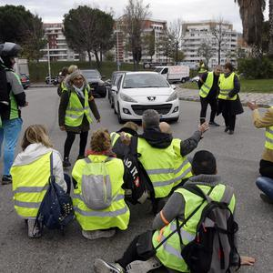 Demonstrators block a crossroads in Marseille (AP Photo/Claude Paris)