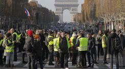 Protesters block the Champs-Elysees to protest fuel taxes (Michel Euler/AP)