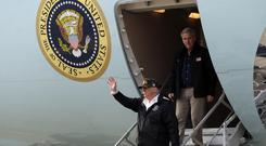 President Donald Trump waves as he arrives on Air Force One at Beale Air Force Base (Evan Vucci/AP)