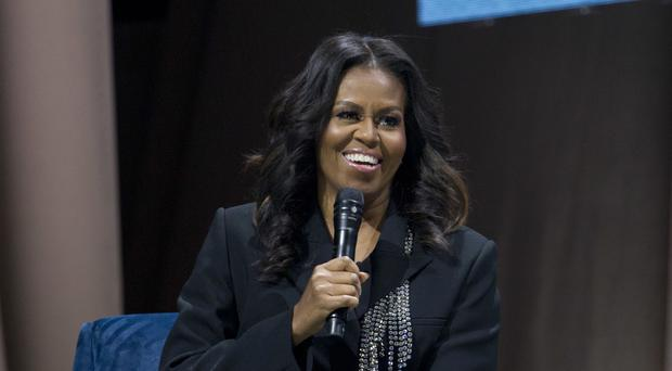 Former first lady Michelle Obama (AP Photo/Jose Luis Magana)