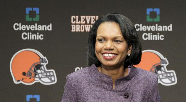 Former US secretary of state Condoleezza Rice talks with the media after visiting the Cleveland Browns (Amy Sancetta/AP)