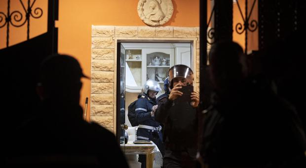 Police enters one of eight illegally built villas belonging to members of the Casamonica criminal clan (Massimo Percossi/AP)