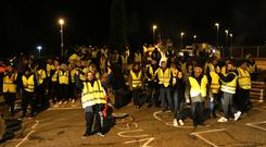 Protesters wearing yellow jackets block a crossroads in Saint-Maximin, southern France (Claude Paris/AP)
