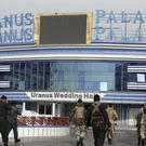Afghan security personnel outside a wedding hall in Kabul a day after the attack (AP Photo/Rahmat Gul)