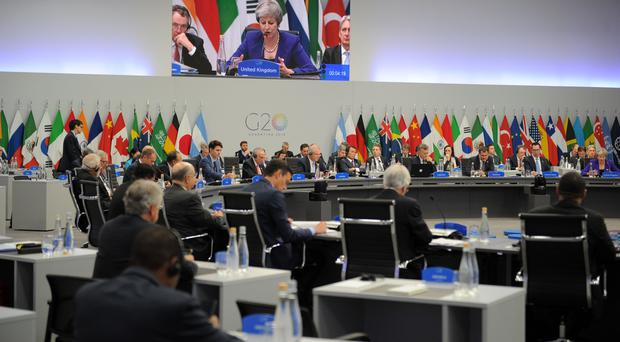 The non-binding agreement was reached after difficult all-night talks by diplomats (G20 Argentina/PA)