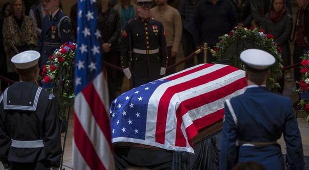 The last visitors pay respects to the late president, George H.W. Bush (AP Photo/J. Scott Applewhite)