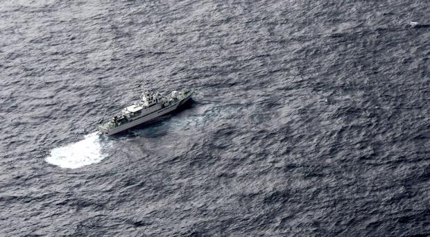 Japan's Coast Guard ship during a search operation for a US Marine refuelling plane and fighter jet off south-western Japan (Kyodo News via AP)