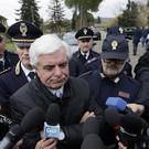 Ancona's head of Police Oreste Capocasa speaks to reporters in front of the disco Lanterna Azzurra (Andrew Medichini/AP)