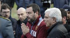 Italian interior minister Matteo Salvini, flanked by Ancona's head of Police Oreste Capocasa, leaves the Lanterna Azzurra after a site inspection (Andrew Medichini/AP)