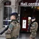 French soldiers patrol in the railway station in Strasbourg (Christophe Ena/AP)