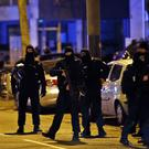 French police officers stand in the Neudorf neighbourhood of Strasbourg (Christophe Ena/AP)