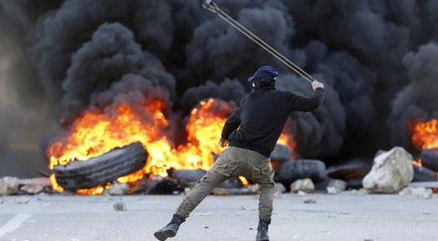 Palestinian protester (AP Photo/Majdi Mohammed)