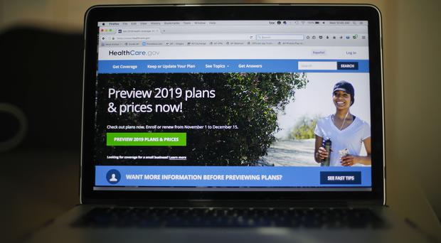 For Americans, it comes on the eve of the sign-up deadline for coverage next year (Pablo Martinez Monsivais/AP)