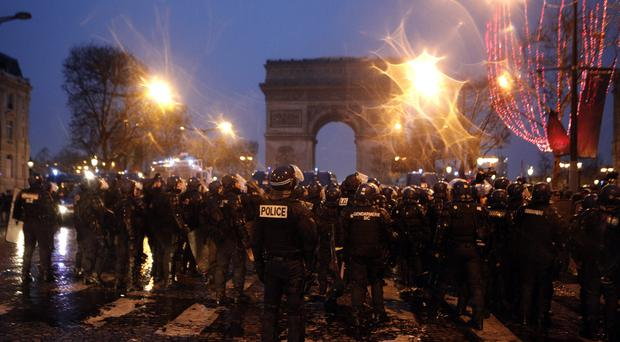 Police secure the Champs-Elysees avenue (Kamil Zihnioglu/AP)