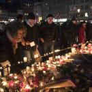 Candles are lit for the victims of the attack (AP)