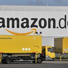 Delivery trucks leave the Amazon Logistics Centre in Rheinberg, Germany (AP)