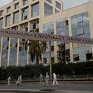 Greek forensic experts search outside the private Greek television station Skai (Petros Giannakouris/AP)