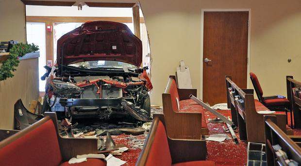 A car that crashed into the entrance of the Crossroads United Methodist Church in Columbus, Ohio (Brooke LaValley/The Columbus Dispatch via AP)
