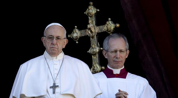 Pope Francis, flanked by Master of Ceremonies Bishop Guido Marini, after the Christmas day blessing (Alessandra Tarantino/AP)