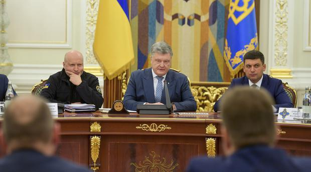 Ukrainian president Petro Poroshenko, centre, leads a National Security and Defence Council meeting in Kiev (Mykola Lazarenko, Presidential Press Service via AP/PA)