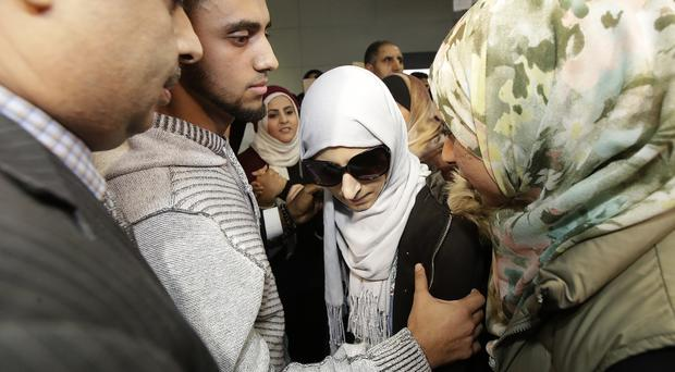 Shaima Swileh, centre, arrived at San Francisco International Airport on December 19 (Jeff Chiu/AP)