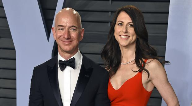 Jeff and MacKenzie Bezos (Agostini/Invision/AP, File)