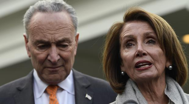 House Speaker Nancy Pelosi stands next to Senate Minority Leader Senator. Chuck Schumer of N.Y., left, following their meeting with President Donald Trump (Susan Walsh/AP)