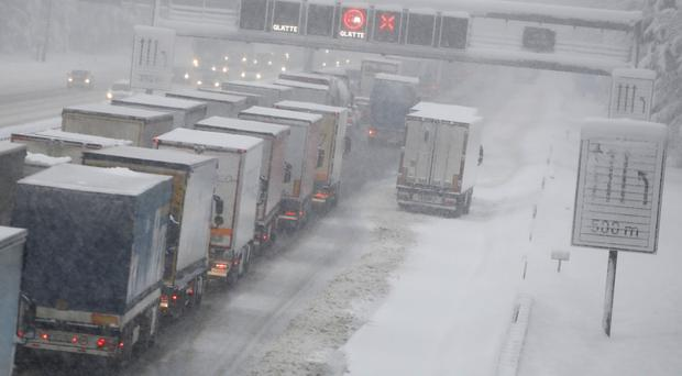 Trucks were left facing long queues n Sauerlach near Munich (Matthias Schrader/AP)