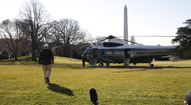 President Donald Trump walks toward the presidential helicopter (Jacquelyn Martin/AP)