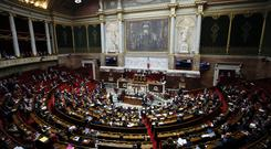 The French National Assembly during the questions to the government in Paris (Francois Mori/AP)