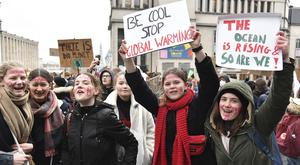 Students hold up placards during a demonstration against climate change in Brussels (Geert Vanden Wijngaert/AP)